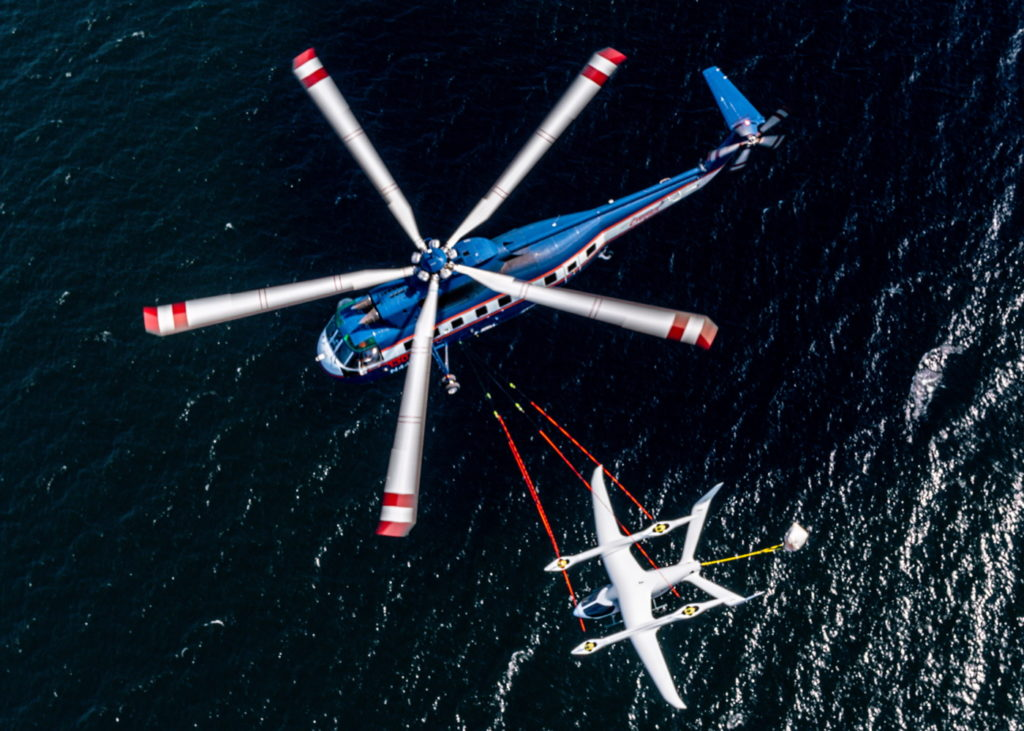 Beta's Alia eVTOL suspended beneath a Helicarrier S-61 during its airlift on June 12. Eric Adams Photo