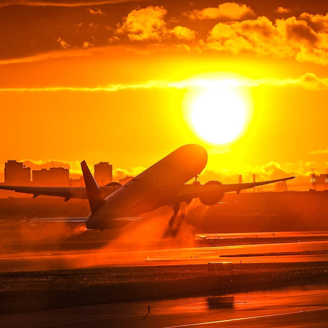 An Air Canada 777-300ER flying off into the sunset from Toronto Pearson. Photo submitted by Instagram user @stage2aviation by tagging @skiesmag.