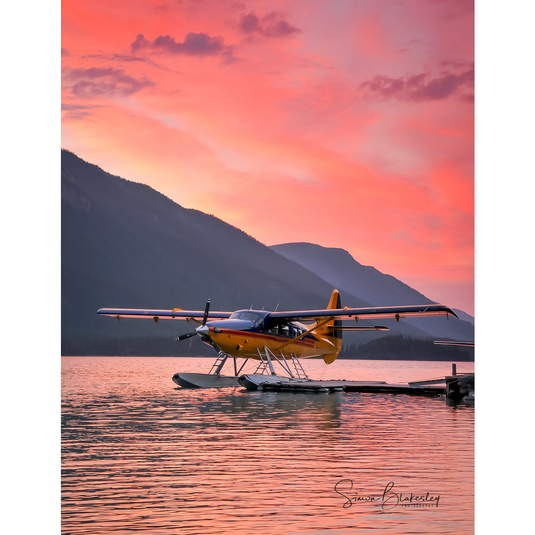 A de Havilland Canada Otter sits on Muncho Lake in Northern British Columbia with gorgeous scenery in the background. Photo submitted by Simon Blakesley (Instagram user @simon_blakesley) using #skiesmag.