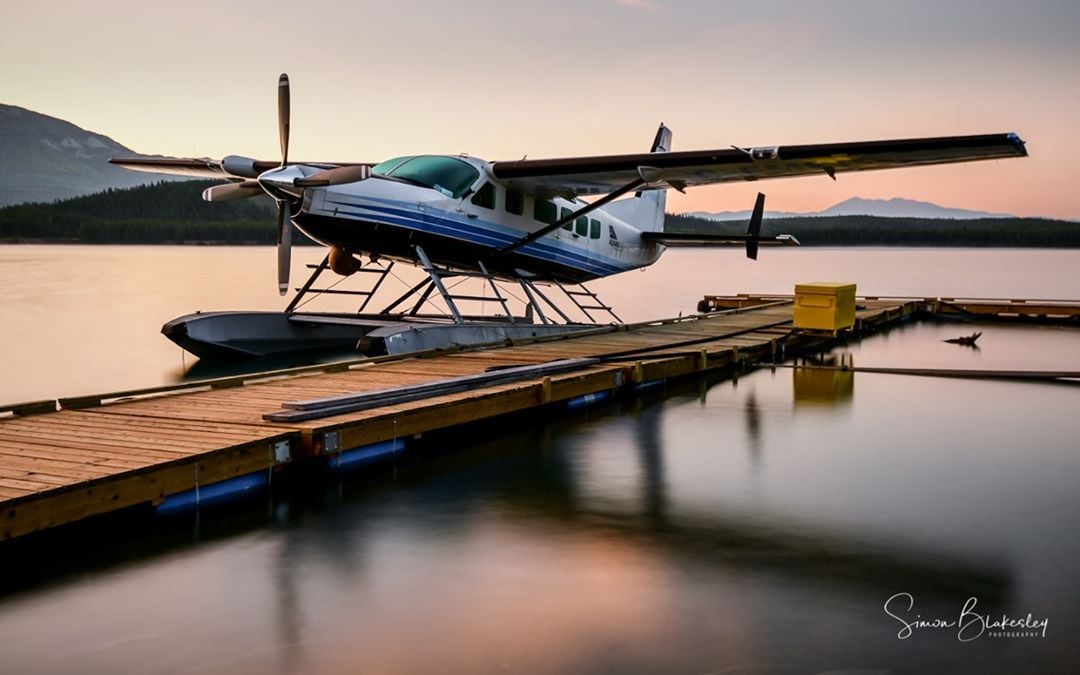 Alkan Air Cessna 208 Caravan I floating on the glass-like Schwatka Lake. Photo submitted by Simon Blakesley (Instagram user @simon_blakesley) using #skiesmag