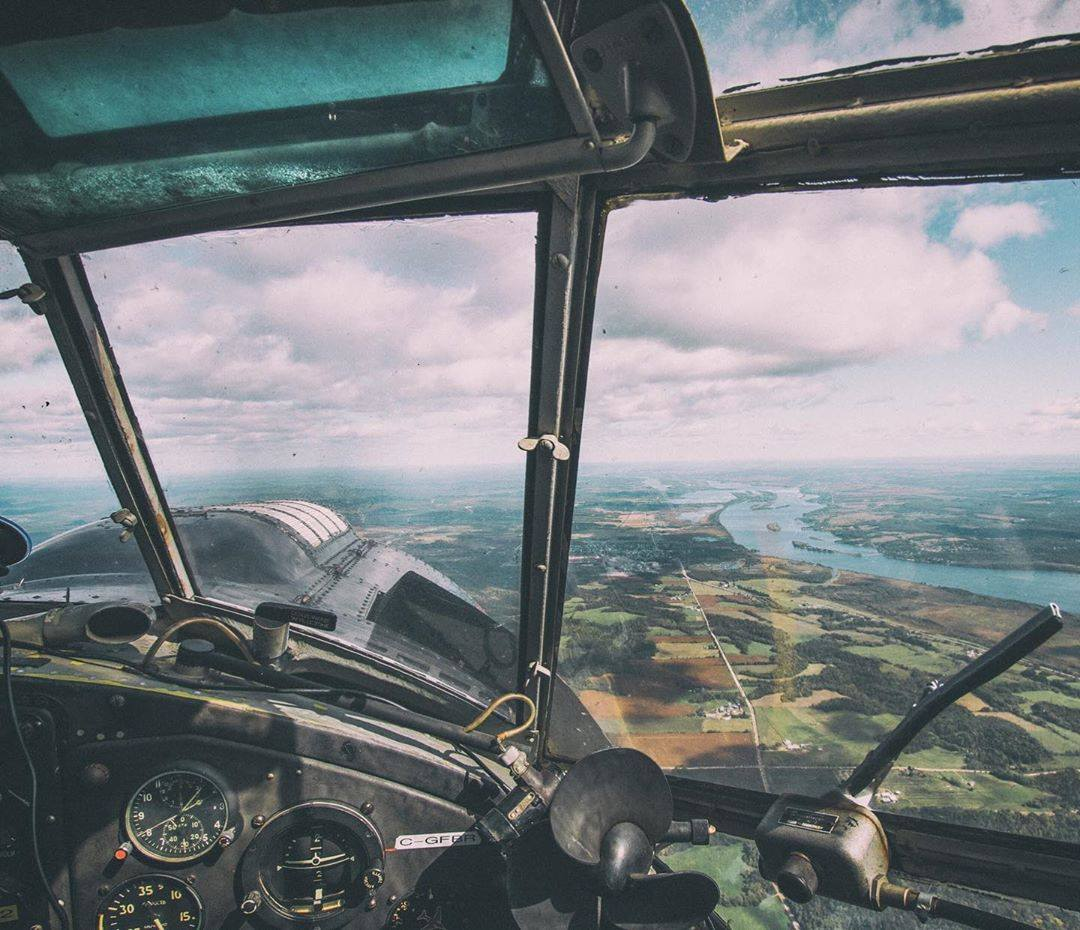 Looking out the cockpit of a vintage Antonov AN-2 during a formation flight above the Ottawa River. Photo submitted by Garret Rodgers (Instagram user @garretrphoto) using #skiesmag