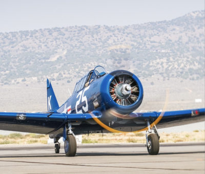 A T-6 warbird with a striking blue paint scheme captured at the 2021 Reno Air Races in Reno, Nevada. Photo by Annie Rusinowski